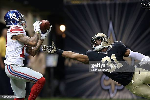 Odell Beckham of the New York Giants catches a touchdown in front of Jairus Byrd of the New Orleans Saints during the third quarter of a game at the...