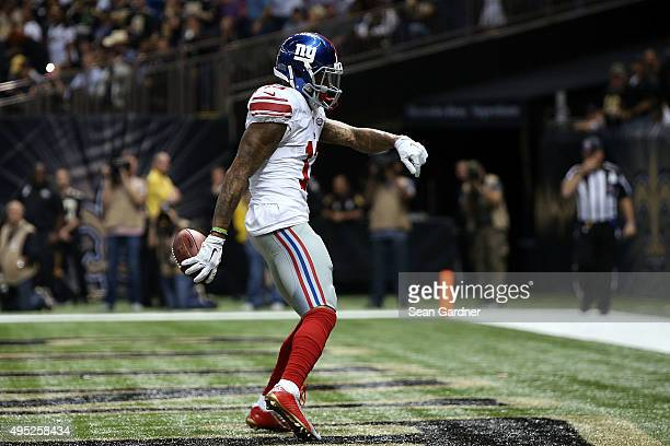Odell Beckham of the New York Giants celebrates a first quarter touchdown against the New Orleans Saints at the MercedesBenz Superdome on November 1...