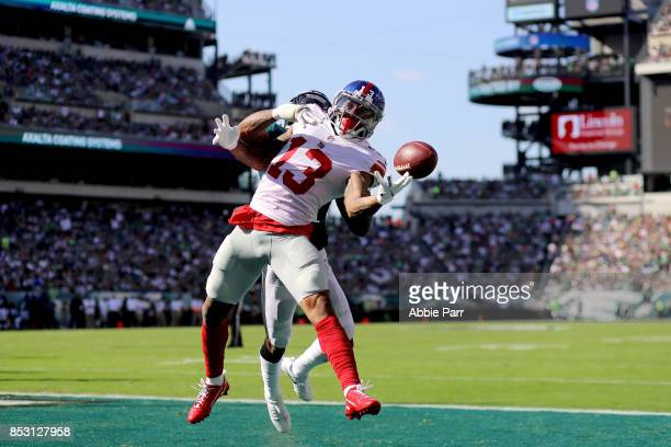 Odell Beckham of the New York Giants completes a four yard touchdown pass against Jalen Mills of the Philadelphia Eagles on September 24 2017 at...