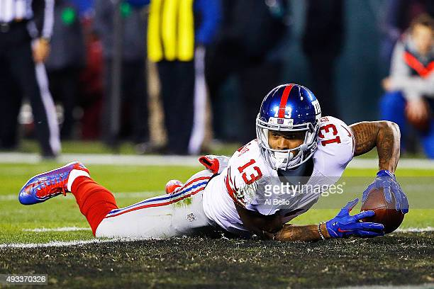 Odell Beckham of the New York Giants dives acros the goaline for a first quarter touchdown against the Philadelphia Eagles at Lincoln Financial Field...