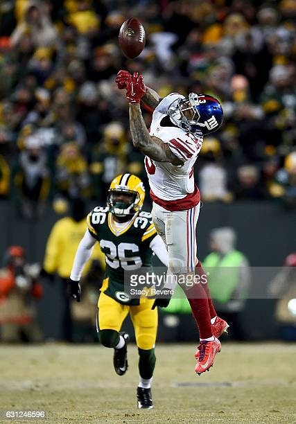 Odell Beckham of the New York Giants fails to make a catch in the fourth quarter during the NFC Wild Card game against the Green Bay Packers at...