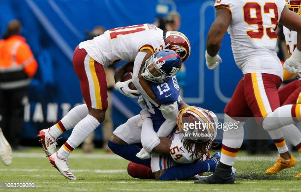 Odell Beckham of the New York Giants in action against Fabian Moreau and Mason Foster of the Washington Redskins on October 28 2018 at MetLife...