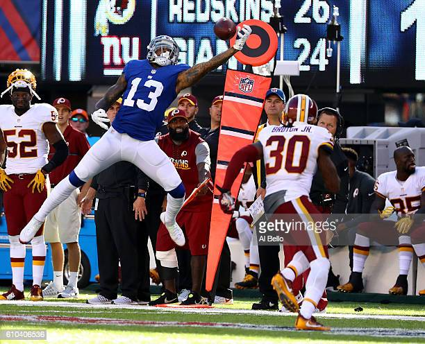 Odell Beckham of the New York Giants makes a catch against David Bruton of the Washington Redskins during their game at MetLife Stadium on September...