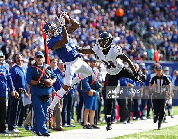 Odell Beckham of the New York Giants makes a catch against Will Davis of the Baltimore Ravens during their game at MetLife Stadium on October 16 2016...