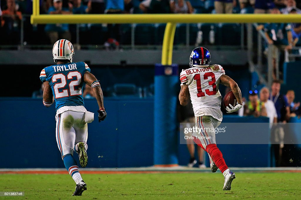 Odell Beckham #13 of the New York Giants runs for a touchdown during the second half of the game against the Miami Dolphins at Sun Life Stadium on December 14, 2015 in Miami Gardens, Florida.