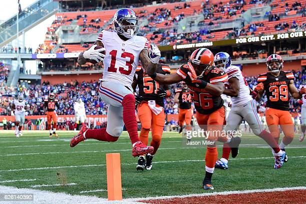 Odell Beckham of the New York Giants scores a second quarter touchdown in front of Marcus Burley of the Cleveland Browns at FirstEnergy Stadium on...