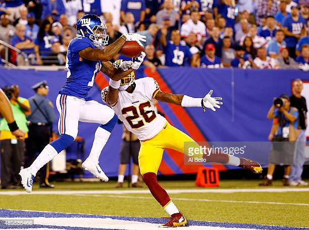 Odell Beckham of the New York Giants scores a touchdown against the defense of Bashaud Breeland of the Washington Redskins in the fourth quarter at...