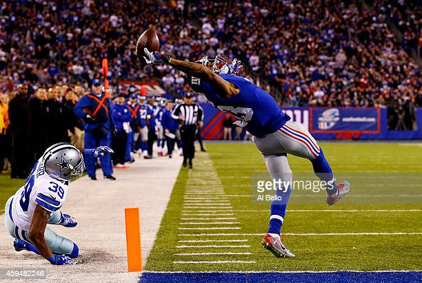 Odell Beckham of the New York Giants scores a touchdown in the second quarter against the Dallas Cowboys at MetLife Stadium on November 23, 2014 in...