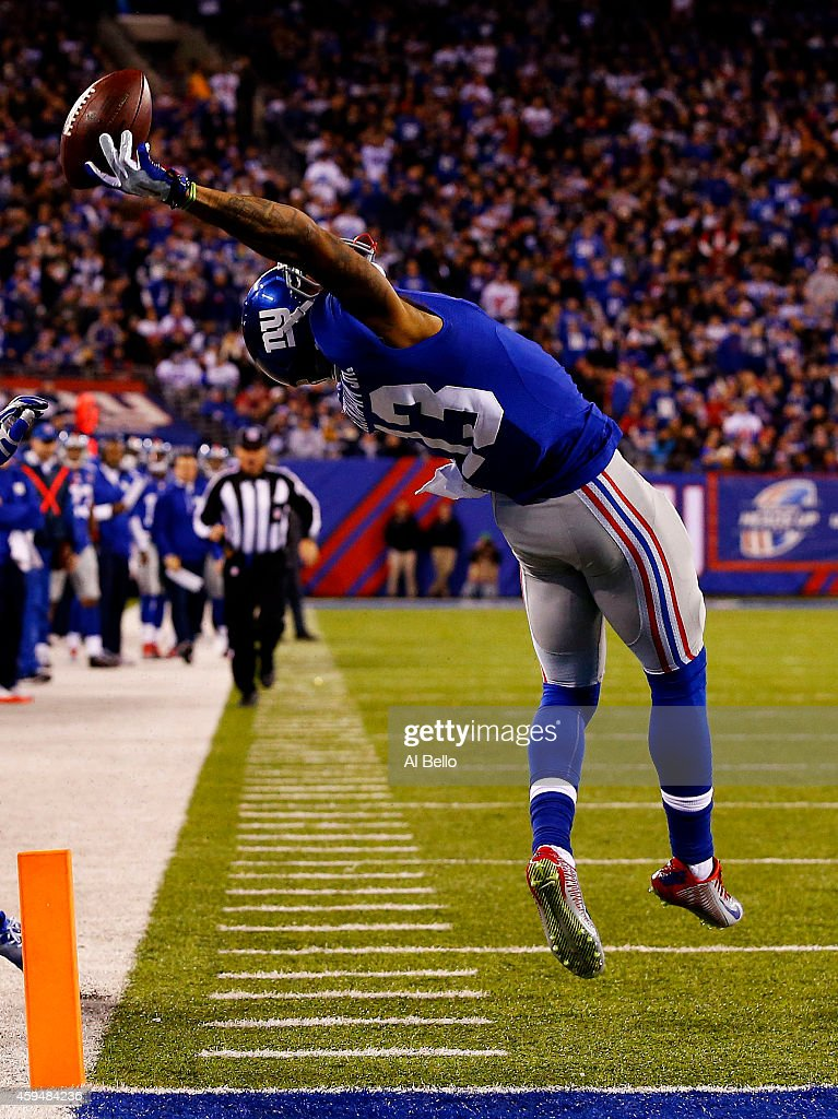 Odell Beckham #13 of the New York Giants scores a touchdown in the second quarter against the Dallas Cowboys at MetLife Stadium on November 23, 2014 in East Rutherford, New Jersey.