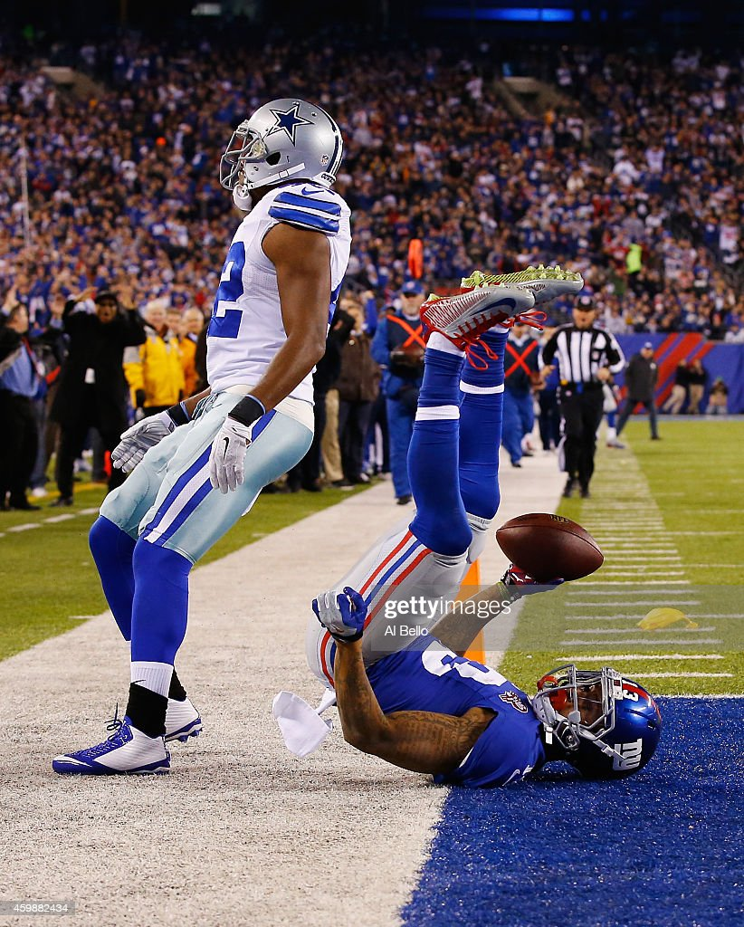 Odell Beckham #13 of the New York Giants scores a touchdown in the second quarter against Brandon Carr #39 of the Dallas Cowboys at MetLife Stadium on November 23, 2014 in East Rutherford, New Jersey.