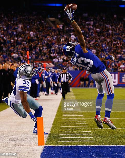 Odell Beckham of the New York Giants scores a touchdown in the second quarter against Brandon Carr of the Dallas Cowboys at MetLife Stadium on...