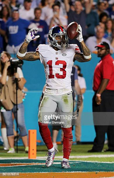 Odell Beckham of the New York Giants signals after catching a touchdown pass during the third quarter of the game against the Miami Dolphins at Sun...