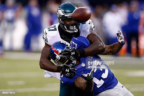 Odell Beckham of the New York Giants tries to make a catch as Malcolm Jenkins of the Philadelphia Eagles defends during a game at MetLife Stadium on...