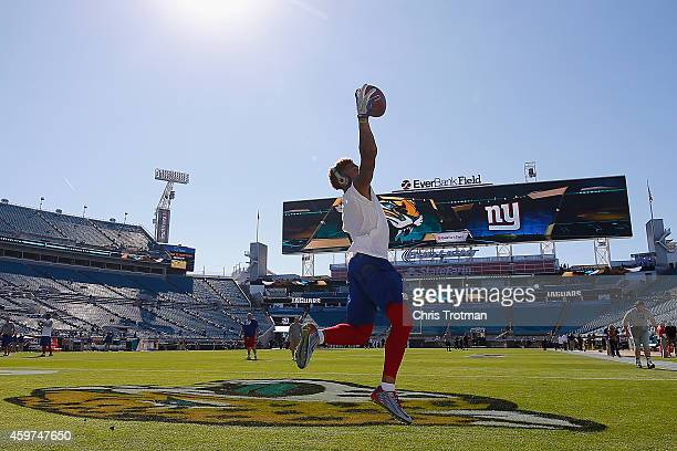 Odell Beckham of the New York Giants warms up prior to a game against the Jacksonville Jaguars at EverBank Field on November 30 2014 in Jacksonville...