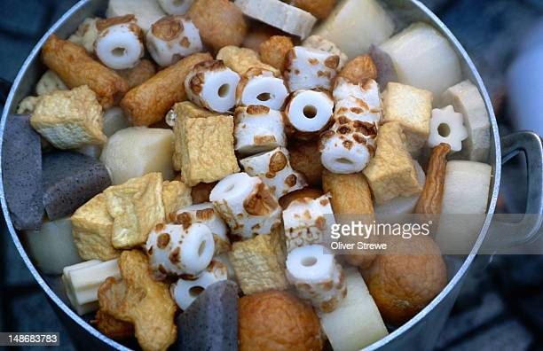 oden, a hearty japanese staple, is a stew of fishcakes, vegetables and tofu in a pot- japan - oden fotografías e imágenes de stock