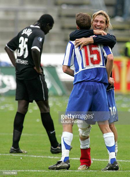 Chris Sorensen and Tobias Grahn of Odense celebrate after scoring against Hertha Berlin during their UEFA Cup first round second leg match 28...