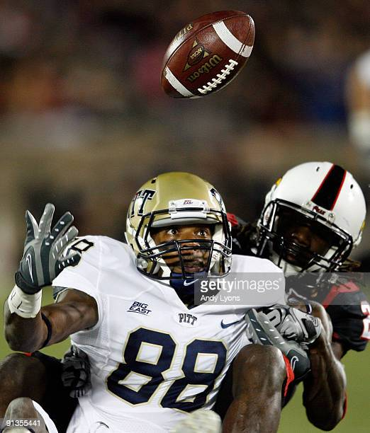 Oderick Turner of the Pittsburgh Panthers reaches for the ball while defended by Richard Raglin of the Louisville Cardinals during the Big East...