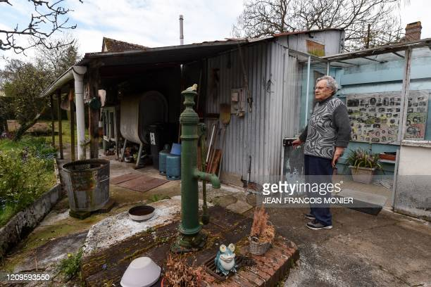 Odette Neveu poses in her garden in Combres western France on April 8 on the 23rd day of a lockdown in France to stop the spread of the COVID19...