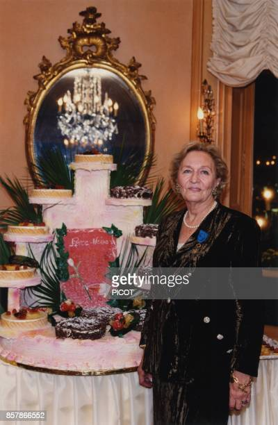 Odette Ventura widow of French actor Lino Ventura receives the French National Order of Merit medal from Simone Veil for her foundation Perce Neige...