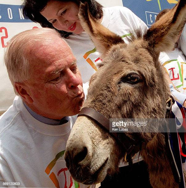 Odie a donkey at Los Angeles Zoo gets a kiss on the cheek from Los Angeles Mayor Richard Riordan under watchful eye Noelia Rodriguez LA Convcention...