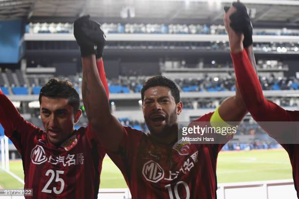 Odil Ahmedov and Hulk of Shanghai SIPG celebrate their side's 10 victory in the AFC Champions League Group F match between Kawasaki Frontale and...
