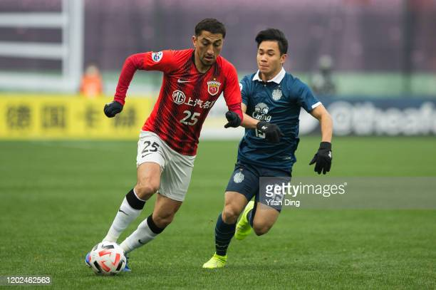 Odil Ahmedov of Shanghai SIPG and Supachok Sarachat of Buriram United in action during the AFC Champions League Preliminary Round match between...