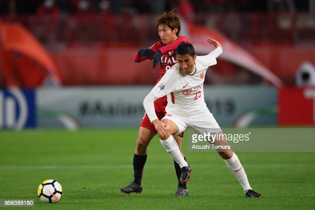 Odil Ahmedov of Shanghai SIPG controls the ball under pressure of Shoma Doi of Kashima Antlers during the AFC Champions League Round of 16 first leg...