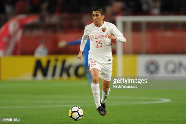 Odil Ahmedov of Shanghai SIPG in action during the AFC Champions League Round of 16 first leg match between Kashima Antlers and Shanghai SIPG at...