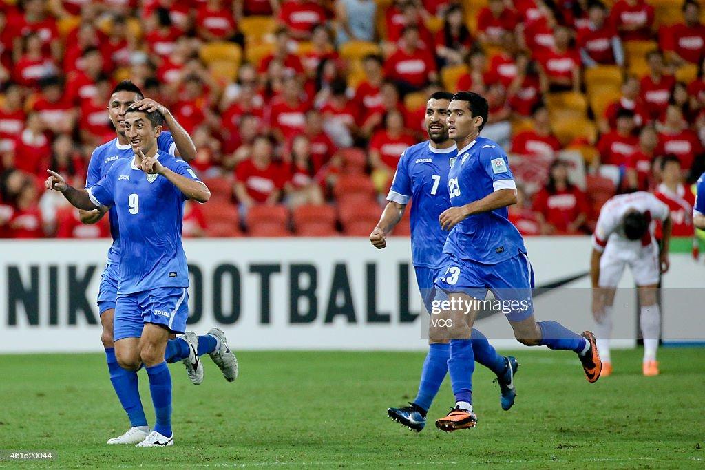 Odil Akhmedov #9, Azizbek Haydarov #7 and Akmal Shorakhmedov #23 of Uzbekistan in action during the 2015 Asian Cup match between China PR and Uzbekistan at Suncorp Stadium on January 14, 2015 in Brisbane, Australia.