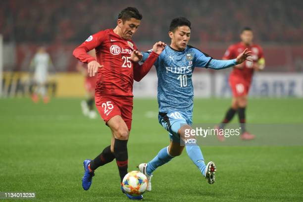 Odil Akhmedov of Shanghai SIPG and Ryota Oshima of Kawasaki Frontale compete for the ball during the AFC Champions League Group H match between...