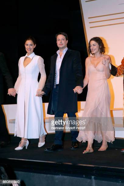 Odile Cohen Davy Sardou and his wife Noemie Elbaz acknowledge the applause of the audience at the end of the Hotel des deux mondes Theater Play at...