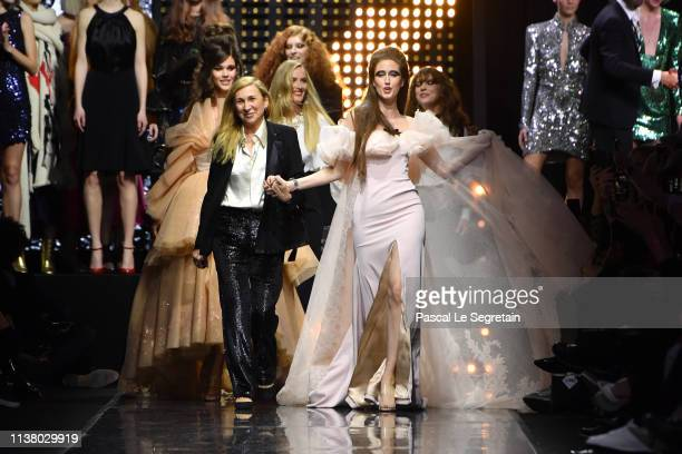 Odile Gilbert and Anna Cleveland walk the runway during 'La FrenchArt Of Coloring' 110th Anniversary of L'Oreal Professional at Carrousel Du Louvre...