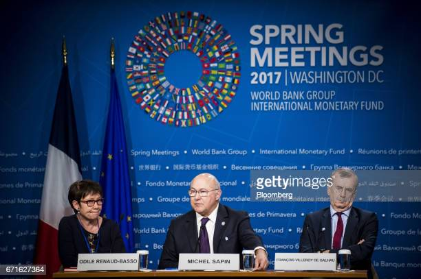 Odile RenaudBasso director general of the French treasury from left Michel Sapin France's finance minister and Francois Villeroy de Galhau governor...