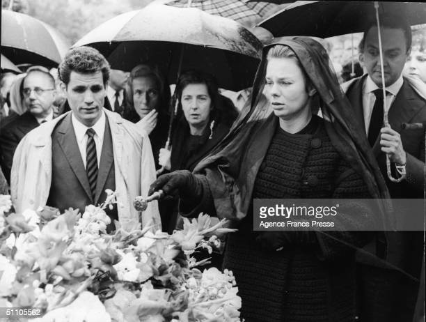 Odile Rodin stands at the flowerstrewn coffin of her late husband Dominican diplomat and socialite Porfirio Rubirosa during his funeral Paris France...