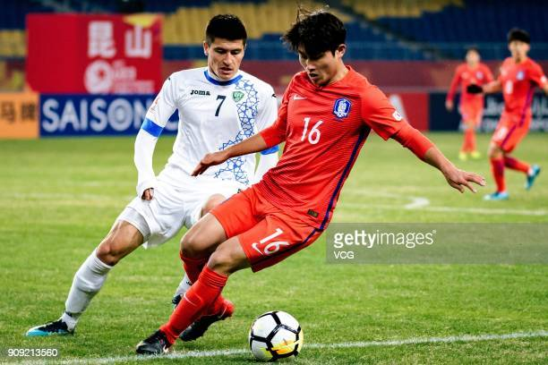 Odiljon Xamrobekov of Uzbekistan and Jang YunHo of South Korea compete for the ball during the AFC U23 Championship semifinal match between...