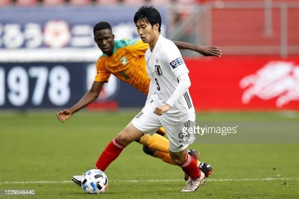 Odilon Kossounou of Ivory Coast, Daichi Kamada or Japan during the friendly match between Japan and Ivory Coast at Stadium Galgenwaard on October 13,...