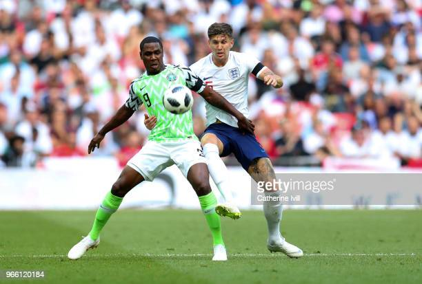 Odin Ighalo of Nigeria battles with John Stones of England during the International Friendly match between England and Nigeria at Wembley Stadium on...