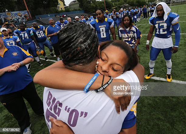 Odin Lloyd's mother Ursula Ward back to camera and girlfriend Shaneah Jenkins share an embrace during a pregame ceremony honoring Lloyd on Jun 27...