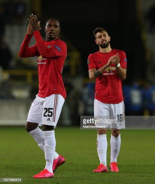 Odion Ighalo and Bruno Fernandes of Manchester United walk off after the UEFA Europa League round of 32 first leg match between Club Brugge and...