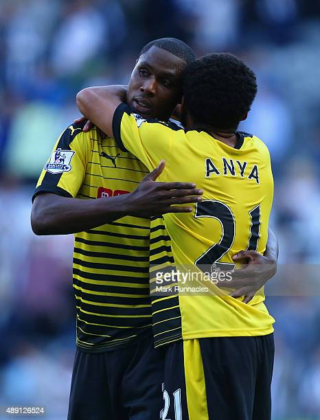 Odion Ighalo and Ikechi Anya of Watford celebrate their team's 21 win in the Barclays Premier League match between Newcastle United and Watford at St...