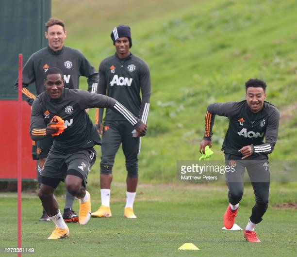 Odion Ighalo and Jesse Lingard of Manchester United in action during a first team training session at Aon Training Complex on September 18 2020 in...