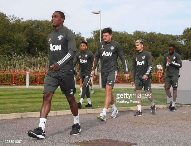 Odion Ighalo Jesse Lingard Harry Maguire Andreas Pereira Aaron WanBissaka of Manchester United in action during a first team training session at Aon...