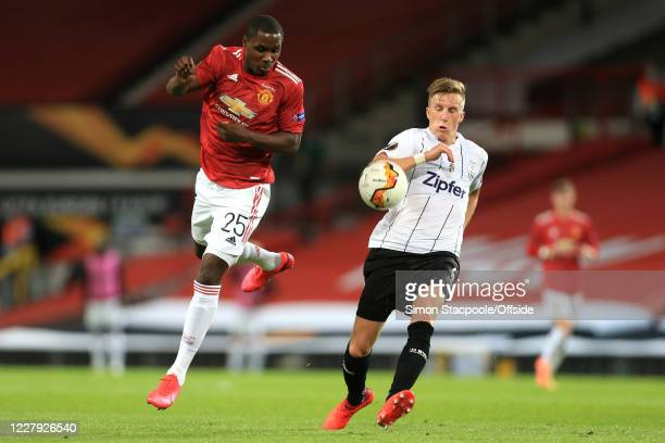 Odion Ighalo of Man Utd and Philipp Wiesinger of LASK during the UEFA Europa League round of 16 second leg match between Manchester United and LASK...