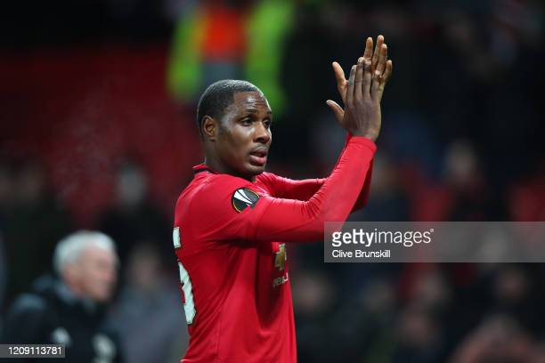 Odion Ighalo of Manchester United applaud fans following his sides victory in the UEFA Europa League round of 32 second leg match between Manchester...