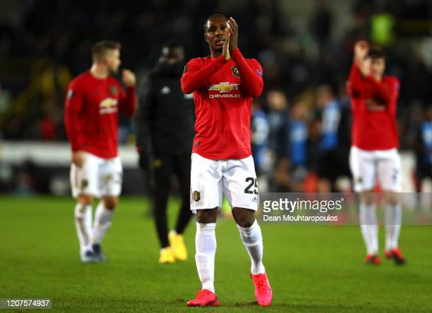 Odion Ighalo of Manchester United applauds fans after the UEFA Europa League round of 32 first leg match between Club Brugge and Manchester United at...