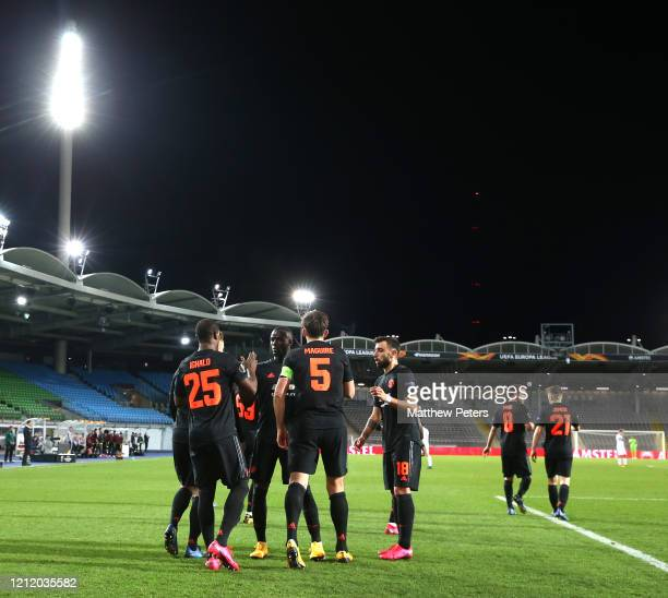 Odion Ighalo of Manchester United celebrates scoring their first goal during the UEFA Europa League round of 16 first leg match between LASK and...