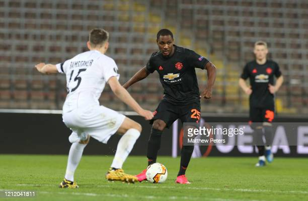 Odion Ighalo of Manchester United in action with Christian Ramsebner of LASK during the UEFA Europa League round of 16 first leg match between LASK...