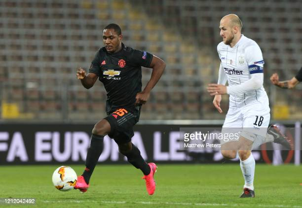 Odion Ighalo of Manchester United in action with Gernot Trauner of LASK during the UEFA Europa League round of 16 first leg match between LASK and...