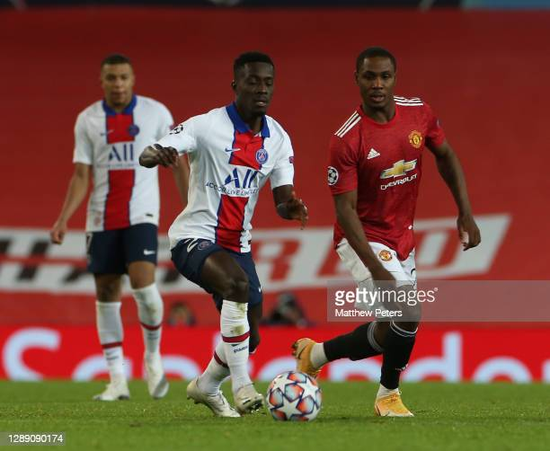 Odion Ighalo of Manchester United in action with Idrissa Gueye of Paris Saint-Germain during the UEFA Champions League Group H stage match between...