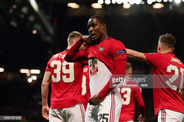 Odion Ighalo of Manchester United lifts his shirt to reveal a tribute to his sister while celebrating after scoring a goal to make it 2-0 during the...